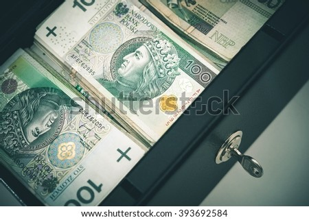 Polish Zloty Cash Money in the Cash Safe Box. Polish One Hundred Zloty Banknotes.