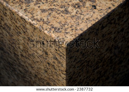 polished granite cube part in natural sunlight