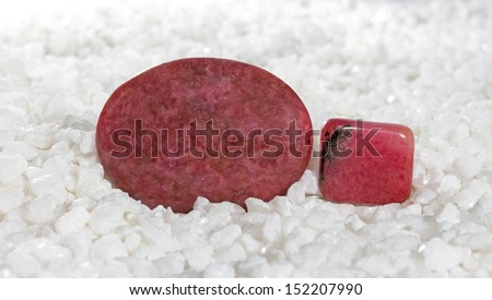 Polished pink to rose-red rhodonite cabochons, a manganese silicate used as an ornamental stone fro carving and jewellery and for the treatment of emphysema and joint inflammation - stock photo