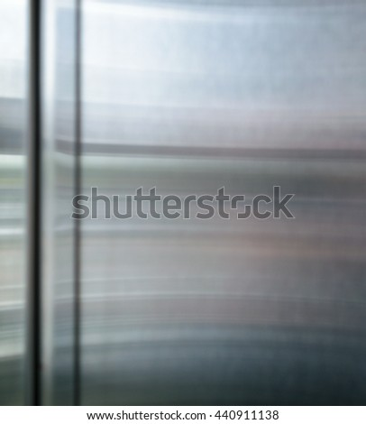 Polished shiny steel metal surface with multicolored reflections and glare - stock photo