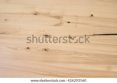 Polished wooden board table with a crack in the wood