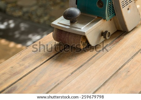 Polishing wood by polish machine - stock photo