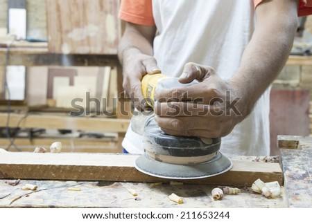 Polishing wood in a Latin carpentry - stock photo