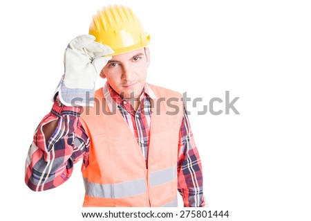 Polite constructor geeting by touching his helmet - stock photo