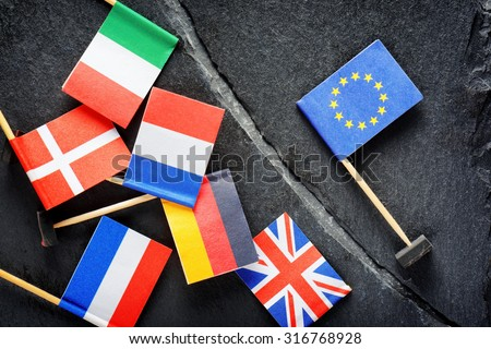 Political concept with flag of the European Union (EU). Flags of European countries separated by crack from flag of the European Union. - stock photo