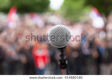 Political protest. Public demonstration. Microphone.  - stock photo