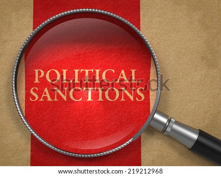 Political Sanctions through Magnifying Glass on Old Paper with Red Vertical Line. - stock photo