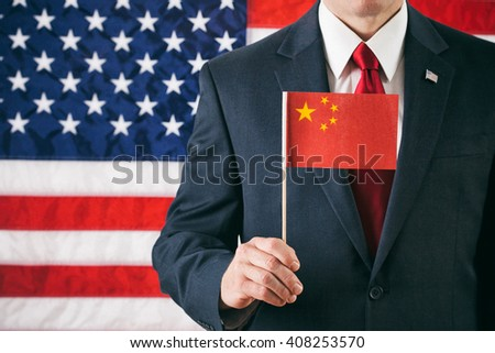 Politician: Man Holding A Chinese Flag - stock photo