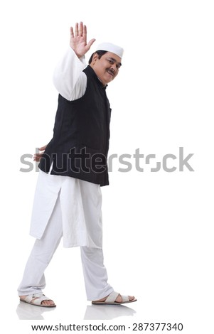 Politician waving over white background - stock photo