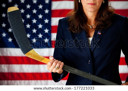 Politician: Woman Holding Hockey Stick