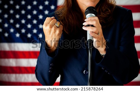 Politician: Woman Speaking Strongly At Microphone - stock photo