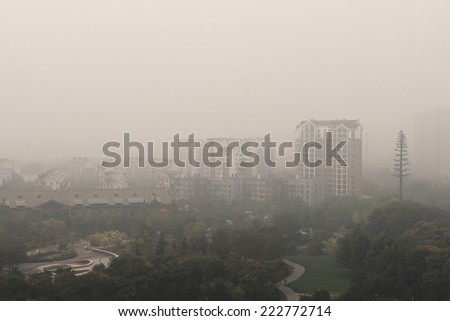 Polluted air over Beijing city. ???????????????? ? ????? - stock photo