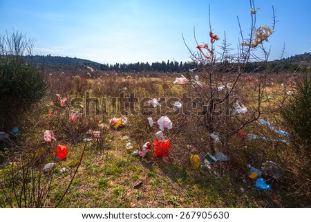 polluted by plastic bags field - stock photo