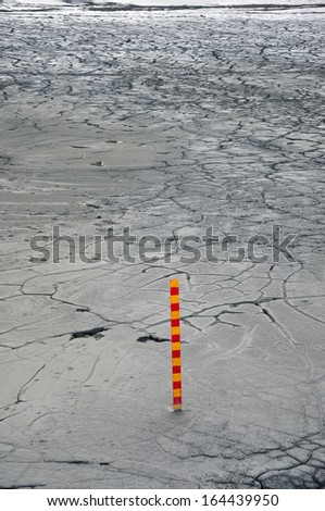 Polluted mud in a copper mine with a measurement scale - stock photo