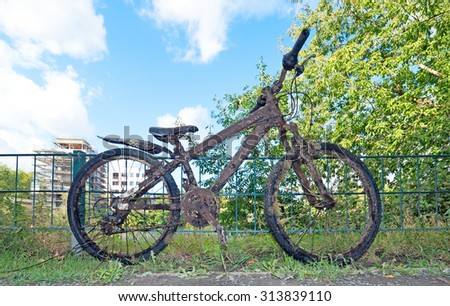 polluted old bike, salvaged from a canal - stock photo