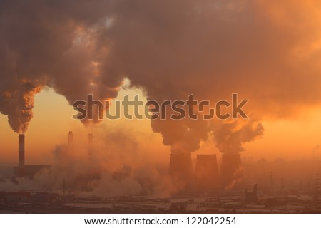 Polluting factory at dawn. also see video 3152725 - stock photo