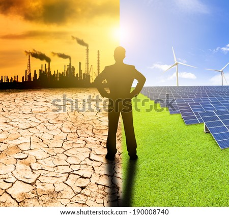 pollution and clean energy concept. businessman watching windmills solar panels and refinery with air pollution - stock photo