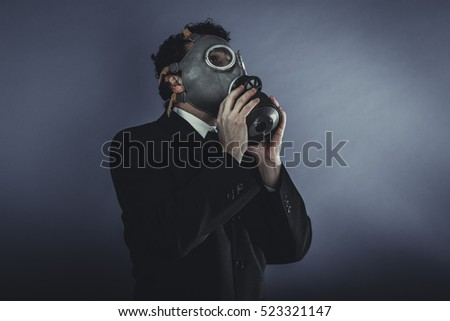 Pollution, Businessman with gas mask, concept business dangerous for the environment or for society