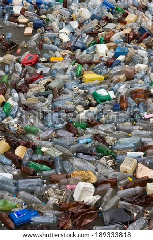 pollution by plastic bottles - stock photo