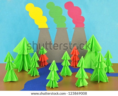 Pollution composition made of origami conifers and paper plant pipes with emissions - stock photo