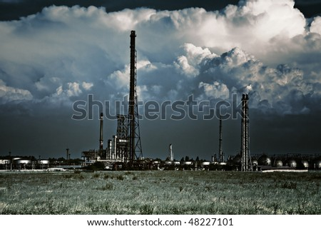Pollution concept - industrial refinery - stock photo
