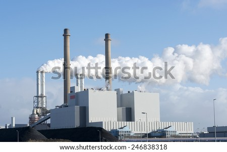 pollution from power plant on the second maasvalkte the new industrial area in holland - stock photo