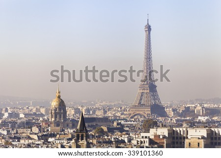Pollution in Paris, aerial view of Eiffel Tower with smog in background