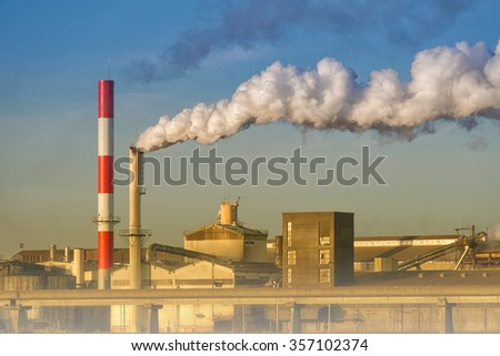 pollution of a factory with smog and chimney smoke - stock photo