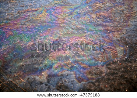 pollution of the environment - Oil Slick on the road - stock photo