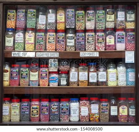 POLPERRO, ENGLAND - AUGUST 26: Jars of sweets displayed in a traditional sweet shop window, August 26, 2013 in Polperro, Cornwall, England.