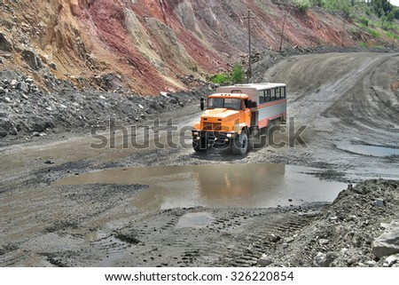 Poltava Region, Ukraine - June 26, 2010: Mining crew bus on the iron ore opencast