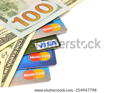 POLTAVA, UKRAINE - JANUARY 24, 2015: Photo of Visa and Mastercard credit card with USA dollars bills isolated on white background