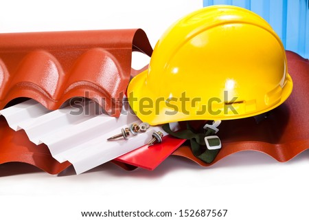 Polycarbonate roof to cover the buildings, screws for mounting, a yellow hard hat on a white background