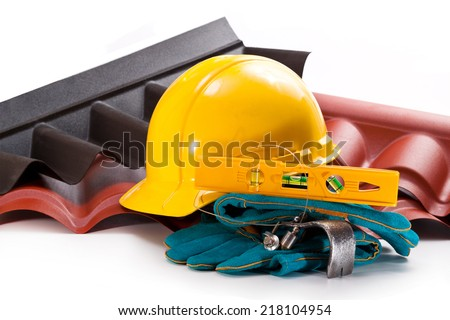 Polycarbonate roof, yellow hardhat, level, mount, gloves, plumb and screws - stock photo