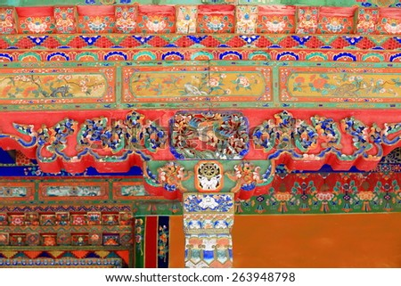 Polychrome carved wooden column-chapiter-rafters of gateway to a pavilion in the 3.6 km2 Norbulingka-Jewelled Park complex. Lhasa-Tibet.  - stock photo