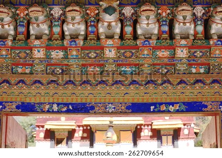 Polychrome carved wooden gateway to the 1755 AD.built Kelsan Phodrang-Old Summer Palace in the 3.6 km2 Norbulingka-Jewelled Park complex. Lhasa-Tibet.  - stock photo