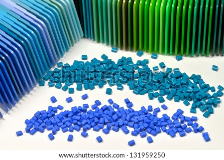 polymer resin dyed in two different blue colors with correspondending color samples - stock photo