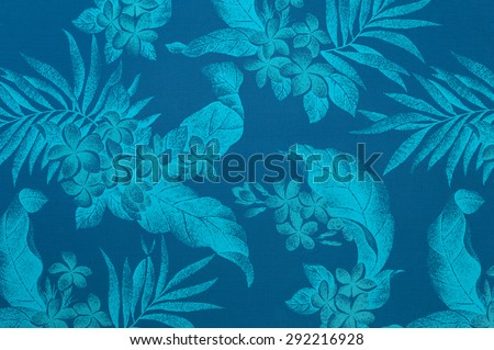 Polynesian background pattern/texture with light blue leaves and plumeria flowers against a faded  blue background. - stock photo