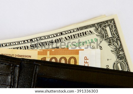Polynesian Francs and US Dollars in a Wallet