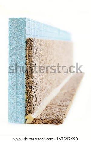 Polystyrene and wooden insulation object isolated on white - stock photo