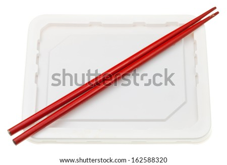 polystyrene cup with instant ramen and red chopsticks - stock photo