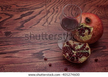 Pomegranate and a glass of red wine. Dinner time.