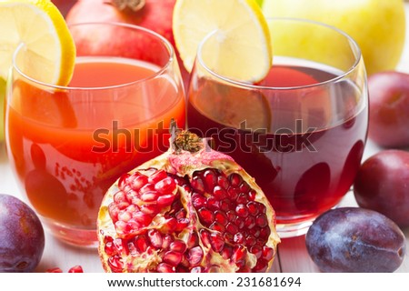 Pomegranate and plum juice with fresh fruits - stock photo