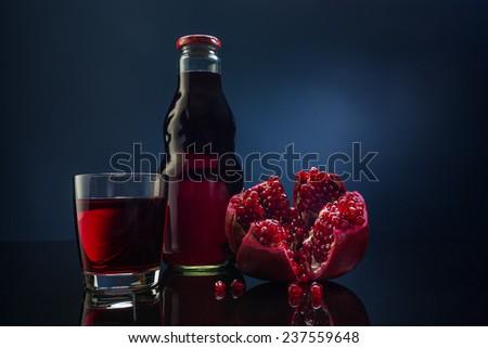 pomegranate and pomegranate juice - stock photo