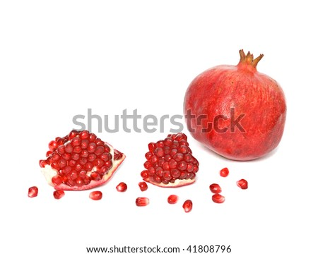 Pomegranate and pomegranate segments  isolated on white background