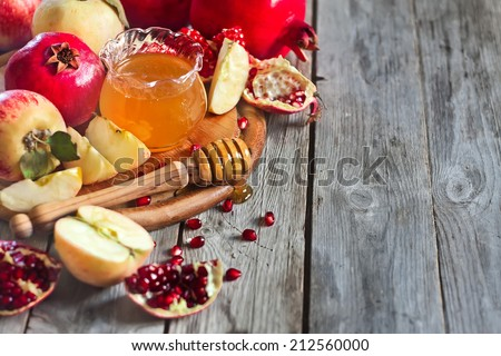 Pomegranate, apple and honey, traditional food of jewish New Year celebration, Rosh Hashana. Selective focus. Copyspace background - stock photo