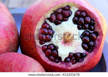 Pomegranate freshly opened - stock photo