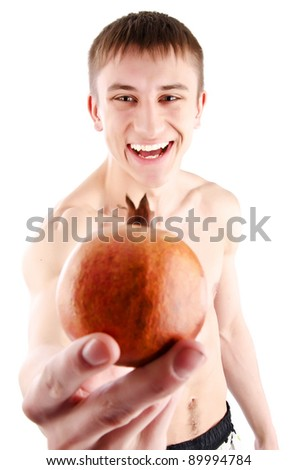 Pomegranate fruit. man showing pomegranate smiling. isolate