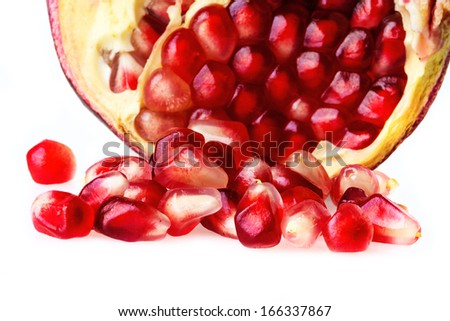 pomegranate fruit seeds on a white background
