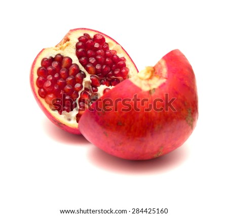 pomegranate fruit split in two, isolated on white background - stock photo